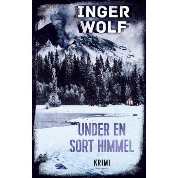 Under en sort himmel af Inger Wolf PaperBack